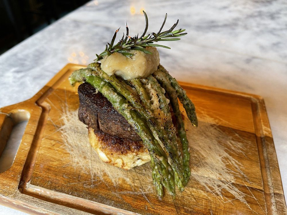 7 Must-Try Bay St. Louis Restaurants: Steak Over Crab Cake and Asparagus